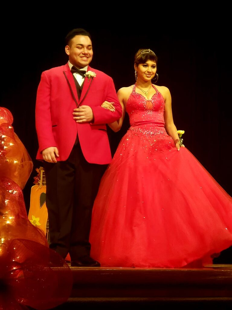 student fashion show couple in red